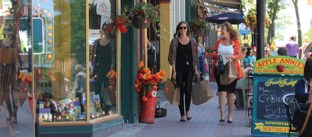 Two ladies walking and shopping along Mississaga Street in Downtown Orillia